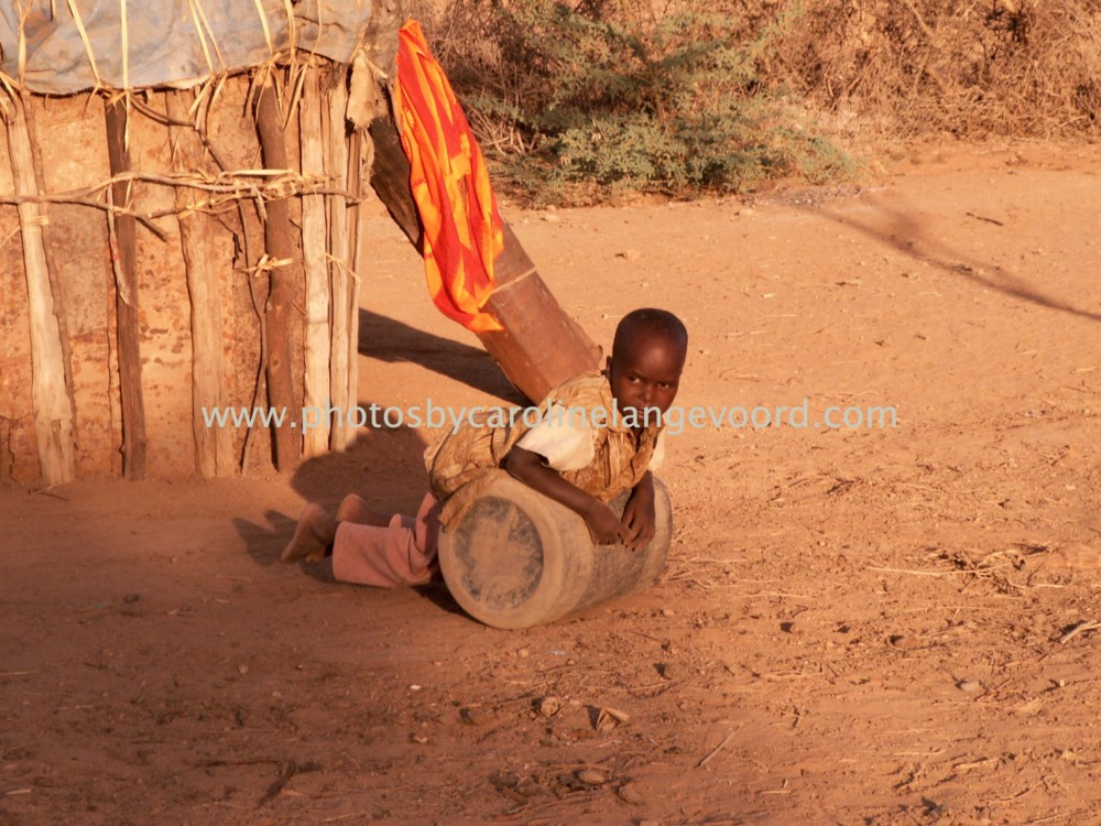 Random work from photos by caroline langevoord | portraits of east africa | playing kid